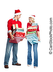 Christmas shopping couple carrying gifts - Caucasian couple...