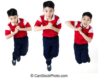 Asian boy  jumping over white background