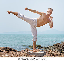 karateka - man practicing on the beach
