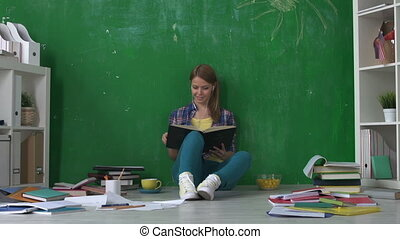 Preparing for Exam - Pretty girl sitting on the floor in...