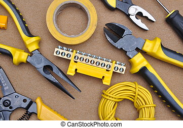 Tools for electrical installation on brown felt