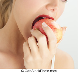 Woman Eating Apple - Young European woman eating red apple