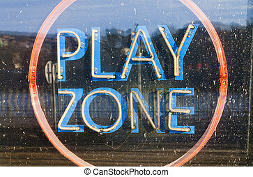 illuminated sign Play zone in the window