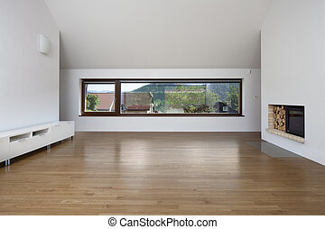 Large window in living room with fireplace