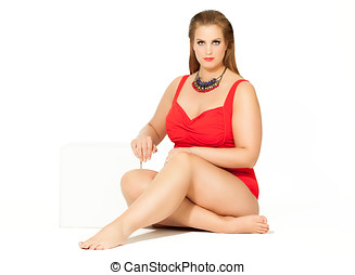 Fashion Plus - Beautiful plus size model wearing red...