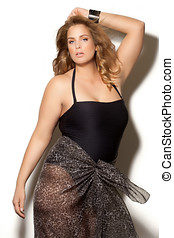 Fashion Plus - Beautiful plus size model wearing swimsuit...