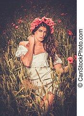 Brunette girl wearing white summer dress and flower chaplet...