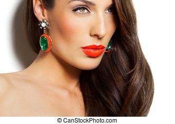 Woman With Earring - Closeup of a model with long dark hair...