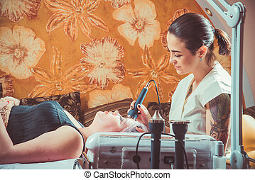 beauty - Beauty salon. Beautician smoothes the skin to the...