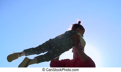 Fun Activity - Low angle of father spinning around with...