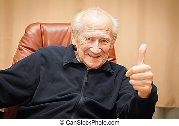 laughing old man with thumbs up - laughing old man sitting...