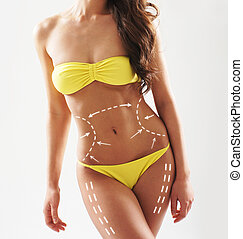 Beautiful and fit female body with the drawing arrows....