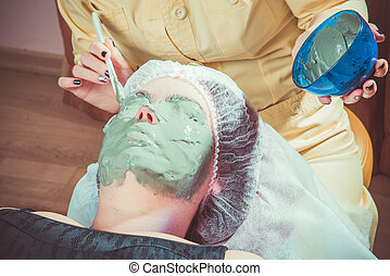 beauty - Beauty salon. Beautician doing cosmetic mask on the...
