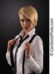 Young attractive woman wearing male shirt over dark