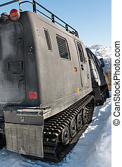 articulated military tracked cargo vehicle on snow: rear...