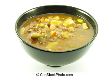 Vegetable Soup in a Black Bowl - Hot chunky vegetable soup...