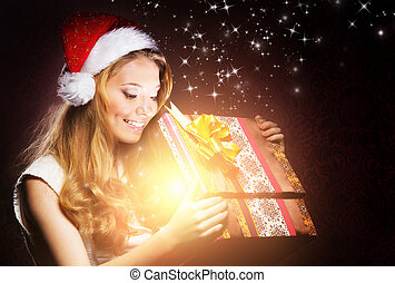 Young teenage girl opening the present - Young, happy and...
