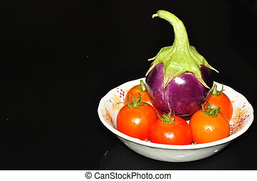 egg plant and tomatoes - purple egg plant and red tomatoes