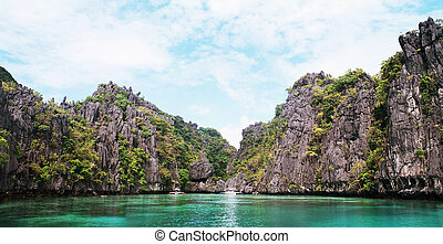 Lagoon and limestone cliff in El Nido - Karst cliff...