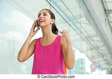 Young Woman On The Phone Smiling For Joy - Portrait of young...