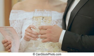 The bride and groom drinking champagne in a registry office...