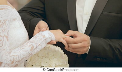 Exchange of wedding rings at wedding ceremony - Exchange of...