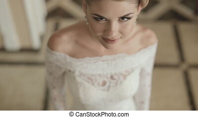 Young bride in tracery wedding dress, top view - Young bride...