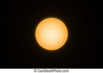 Yellow sun with sunspots
