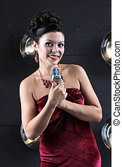 Adult woman with microphone singing