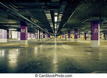 Parking garage underground interior, neon lights in dark...