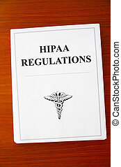 HIPAA Regulations documents on a desk