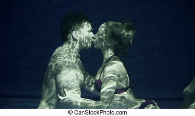 Underwater Romance - Sweet couple kissing under water