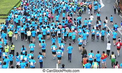 marathon runners on the street - SHENZHEN,CHINA - DECEMBER...
