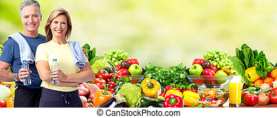 Healthy senior couple. - Healthy senior couple over fresh...