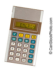 Old calculator - energy - Old calculator showing a text on...