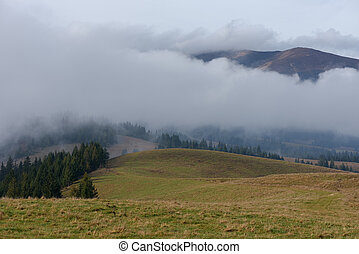 Low clouds in the mountains - Autumn landscape Low clouds in...