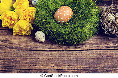 Easter decorations on a dark textured surface, Toned image