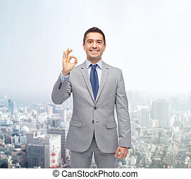 happy businessman in suit showing ok hand sign - business,...