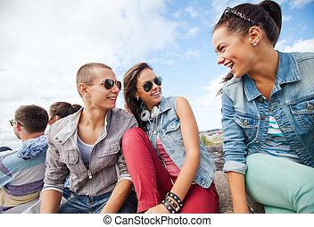 group of teenagers hanging out - summer holidays and teenage...