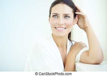 Smiling Woman - Smiling 30 year old woman at the window