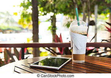 Iced coffee with tablet