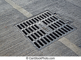 sewer manhole cover in a city street