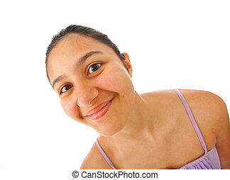 Close up of a teenage girl with surprised expression on...