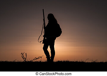 Women hunter - Woman Hunter Silhouetted in Sunset