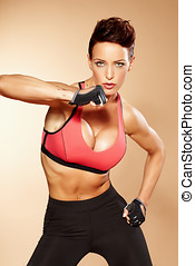 Combat Woman - Sexy woman wearing training clothes and...
