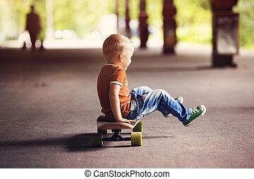 Little boy - Cute little boy with his skateboard on a walk...