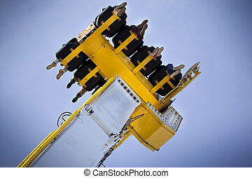 Ride - Teens on a fairground ride in a luna park