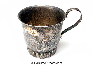 Tarnished Cup - A tarnished cup in front of a white...