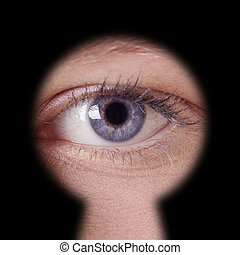 eye looking through keyhole - close-up of human female blue...