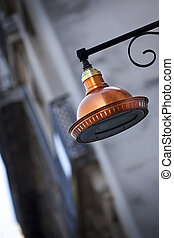 Street lamp - Copper street lamp in a French town
